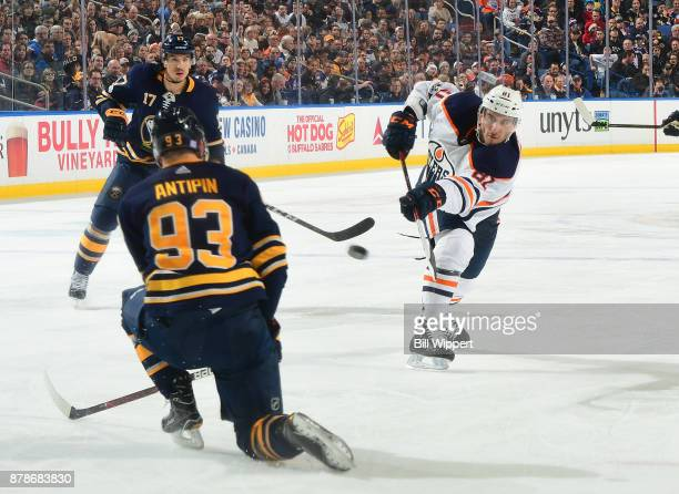 Yohann Auvitu of the Edmonton Oilers fires a shot against Victor Antipin of the Buffalo Sabres during an NHL game on November 24 2017 at KeyBank...