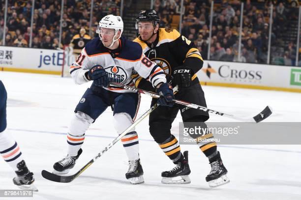 Yohann Auvitu of the Edmonton Oilers skates against Jordan Szwarz of the Boston Bruins at the TD Garden on November 26 2017 in Boston Massachusetts