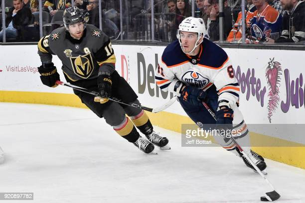 Yohann Auvitu of the Edmonton Oilers skates with the puck while James Neal of the Vegas Golden Knights defends during the game at TMobile Arena on...
