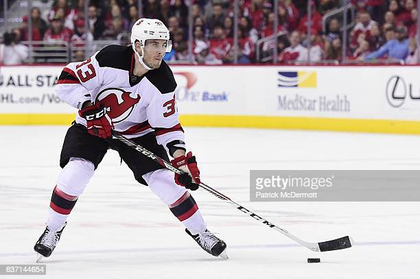 Yohann Auvitu of the New Jersey Devils controls the puck against the Washington Capitals in the second period during a NHL game at Verizon Center on...