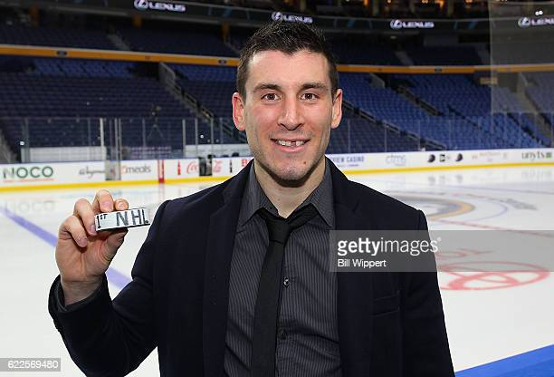 Yohann Auvitu of the New Jersey Devils holds the puck from scoring his first career NHL goal in a 21 overtime win against the Buffalo Sabres at the...
