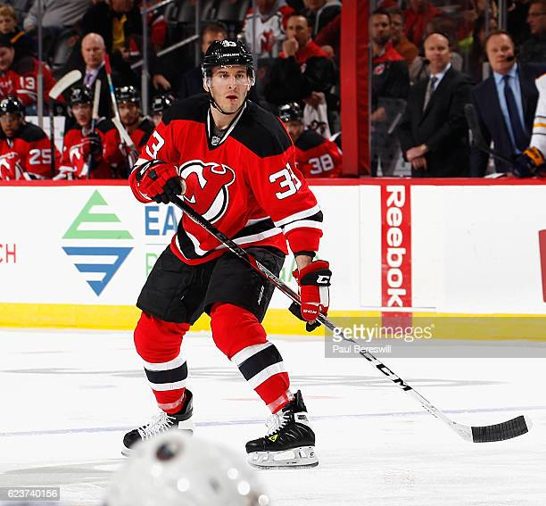 Yohann Auvitu of the New Jersey Devils skates in an NHL hockey game against the Buffalo Sabres at Prudential Center on November 12 2016 in Newark New...
