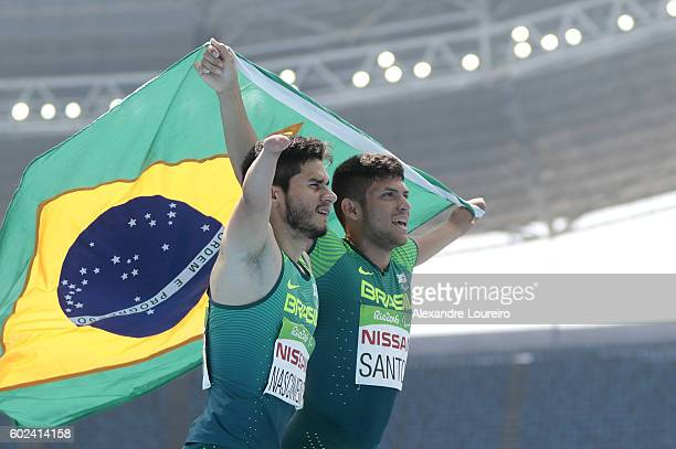 Yohansson Nascimento and Petrucio Ferreira dos Santos of Brazil celebrates after the Petrucio's victory in the Men's100 meter T47 final at Olympic...