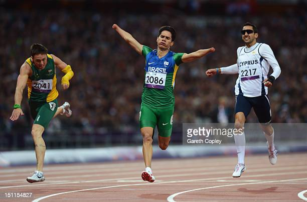 Yohansson Nascimento of Brazil crosses the line ahead of Simon Patmore of Australia and Antonis Aresti of Cyprus in the Men's 200m T46 Final to win...