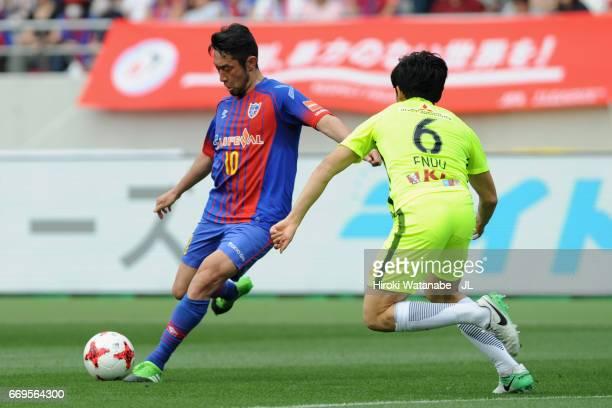 Yohei Kajiyama of FC Tokyo takes on Wataru Endo of Urawa Red Diamonds during the J.League J1 match between FC Tokyo and Urawa Red Diamonds at...