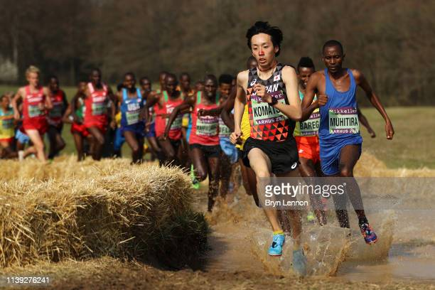 Yohei Komatsu of Japan and Felicien Muhitira of Rwanda compete in the Senior Men's final during the IAAF World Athletics Cross Country Championships...