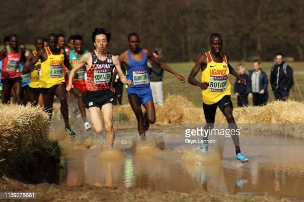 Yohei Komatsu of Japan Felicien Muhitira of Rwanda and Maxwell Rotich of Uganda compete in the Senior Men's final during the IAAF World Athletics...