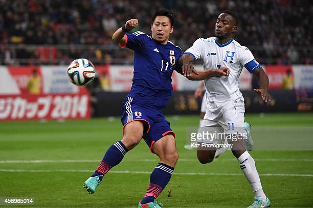 Yohei Toyoda of Japan competes for the ball with Maynor Figueroa of Honduras during the international friendly match between Japan and Honduras at...