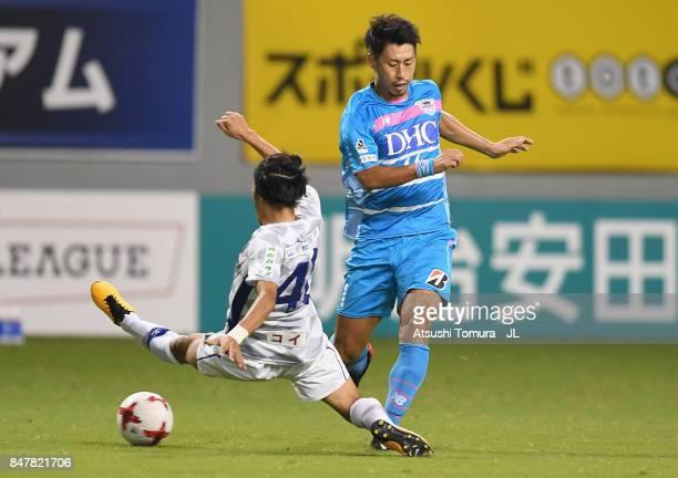 Yohei Toyoda of Sagan Tosu and Shohei Ogura of Ventforet Kofu compete for the ball during the JLeague J1 match between Sagan Tosu and Ventforet Kofu...
