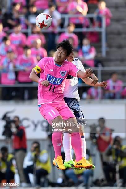 Yohei Toyoda of Sagan Tosu and Takashi Kanai of Yokohama F.Marinos compete for the ball during the J.League J1 match between Sagan Tosu and Yokohama...