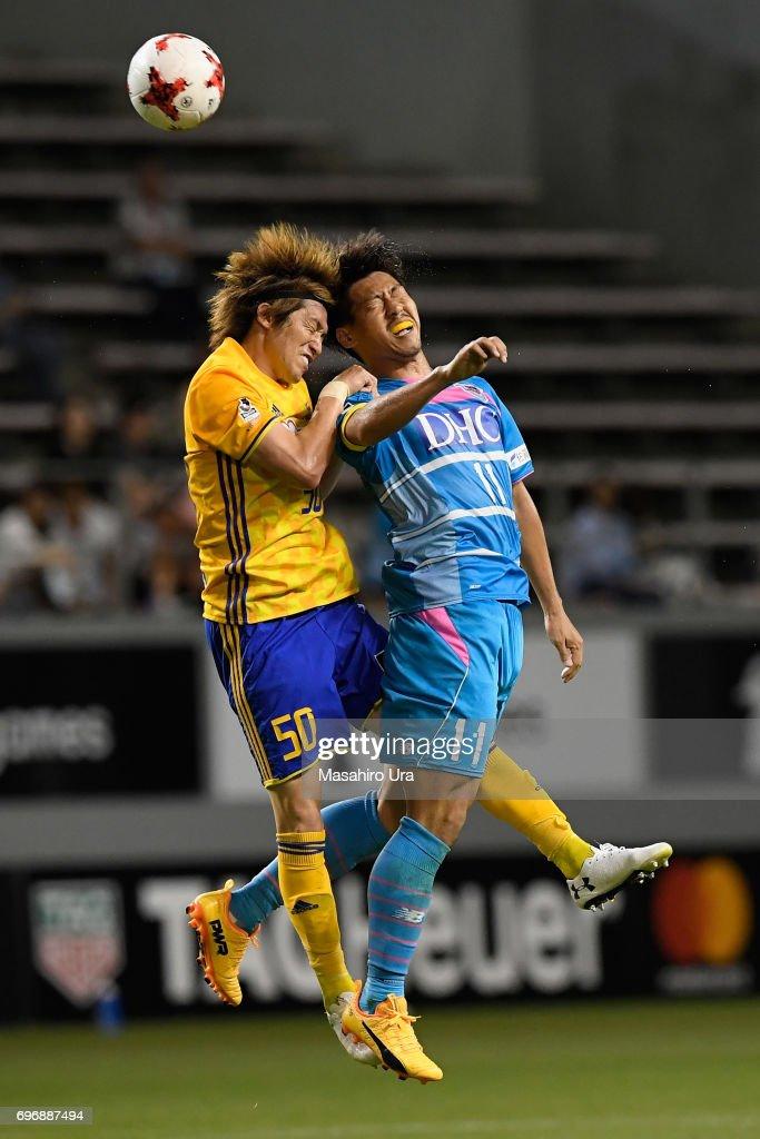 Yohei Toyoda of Sagan Tosu and Tatsuya Masushima of Vegalta Sendai compete for the ball during the J.League J1 match between Sagan Tosu and Vegalta Sendai at Best Amenity Stadium on June 17, 2017 in Tosu, Saga, Japan.