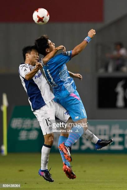 Yohei Toyoda of Sagan Tosu and Yasuyuki Konno of Gamba Osaka compete for the ball during the JLeague J1 match between Sagan Tosu and Gamba Osaka at...