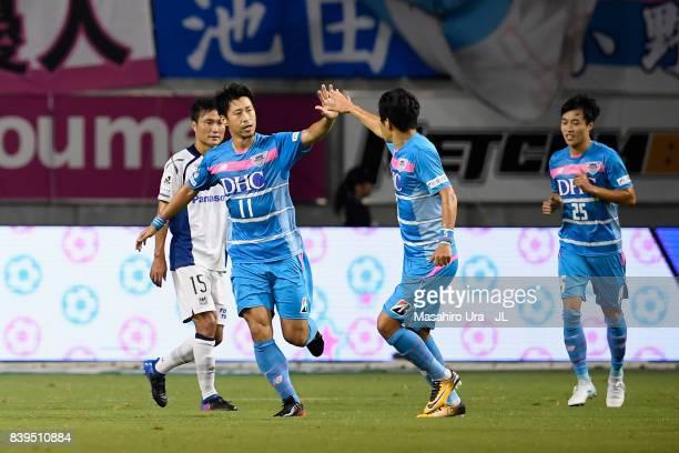 Yohei Toyoda of Sagan Tosu celebrates scoring his side's first goal with his team mate Kim Min Hyeok during the JLeague J1 match between Sagan Tosu...