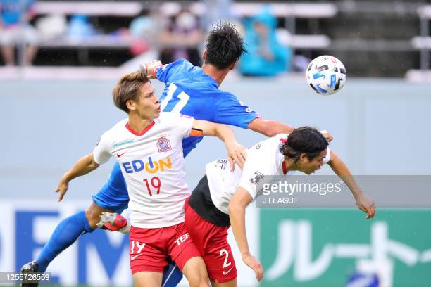 Yohei Toyoda of Sagan Tosu competes for the ball against Sho Sasaki and Yuki Nogami of Sanfrecce Hiroshima during the J.League Meiji Yasuda J1 match...