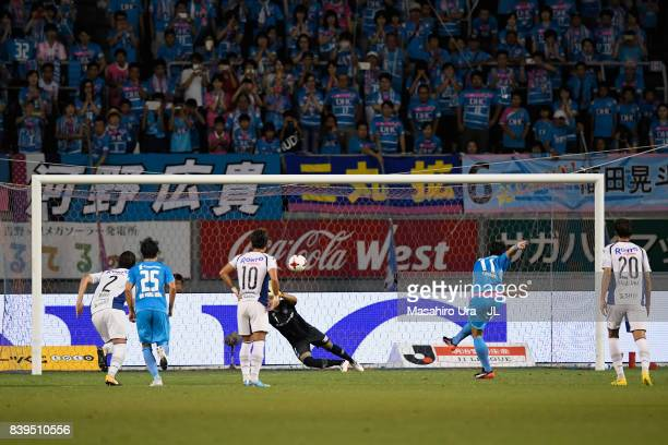 Yohei Toyoda of Sagan Tosu converts the penalty to score his side's first goal past Masaaki Higashiguchi of Gamba Osaka during the JLeague J1 match...