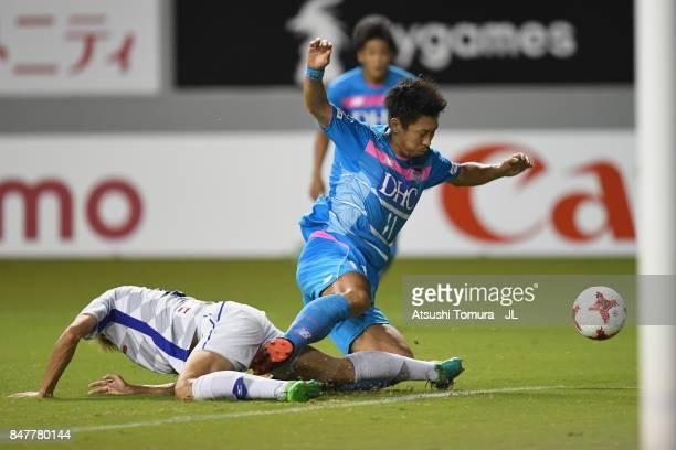 Yohei Toyoda of Sagan Tosu is tackled by Ryohei Arai of Ventforet Kofu during the JLeague J1 match between Sagan Tosu and Ventforet Kofu at Best...
