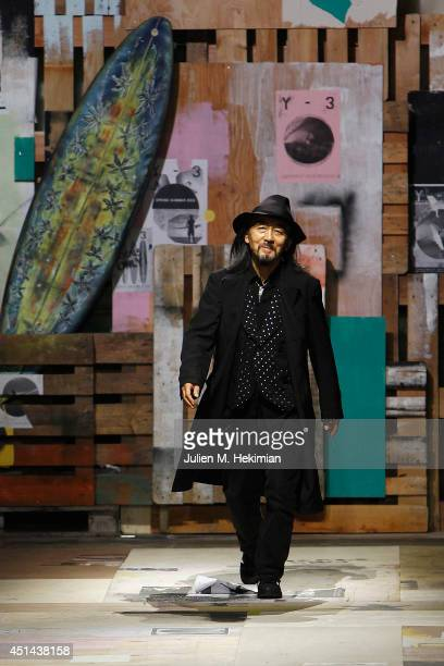 Yohji Yamamoto acknowledges the applause of the audience after the Y-3 Spring/Summer 2015 Show as part of Paris Fashion Week Menswear S/S 2015 at...