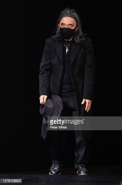Yohji Yamamoto acknowledges the applause of the public after the Yohji Yamamoto Womenswear Spring/Summer 2021 show as part of Paris Fashion Week on...