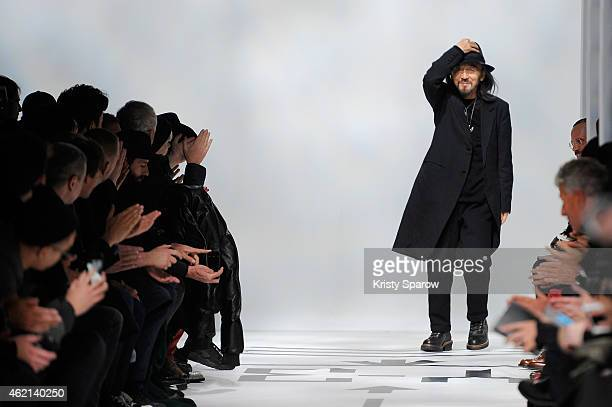 Yohji Yamamoto acknowledges the audience during the Y-3 Menswear Fall/Winter 2015-2016 show as part of Paris Fashion Week at Couvent des Cordeliers...