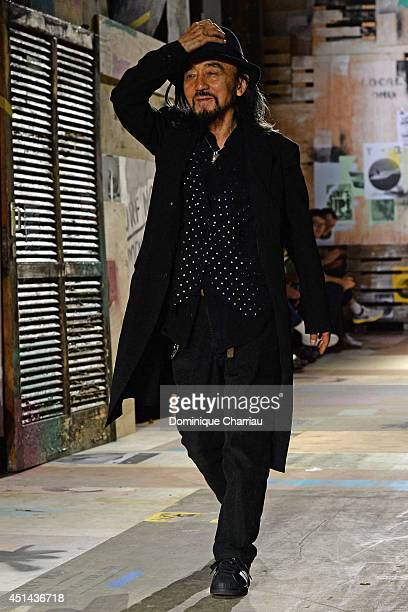 Yohji Yamamoto greats the audience at the end of the Y-3 Spring/Summer 2015 Show as part of Paris Fashion Week Menswear S/S 2015 at Couvent des...