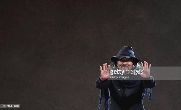 Yohji Yamamoto waves at the end of the Yohji Yamamoto fashion show 'Cutting Age' at St. Agnes Church on April 25, 2013 in Berlin, Germany.