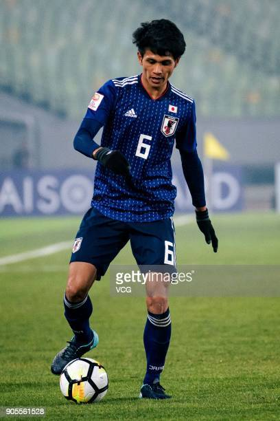 Yoichi Naganuma of Japan drives the ball during the AFC U23 Championship Group B match between Japan and North Korea at Jiangyin Stadium on January...