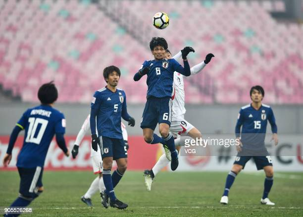 Yoichi Naganuma of Japan heads the ball during the AFC U23 Championship Group B match between Japan and North Korea at Jiangyin Stadium on January 16...