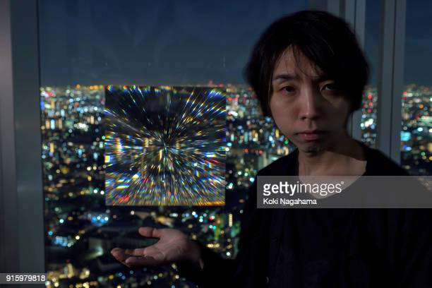 Yoichi Ochiai poses for a photographs at the Media Ambition Tokyo at Roppongi Hills on February 8 2018 in Tokyo Japan The analog optical machine that...
