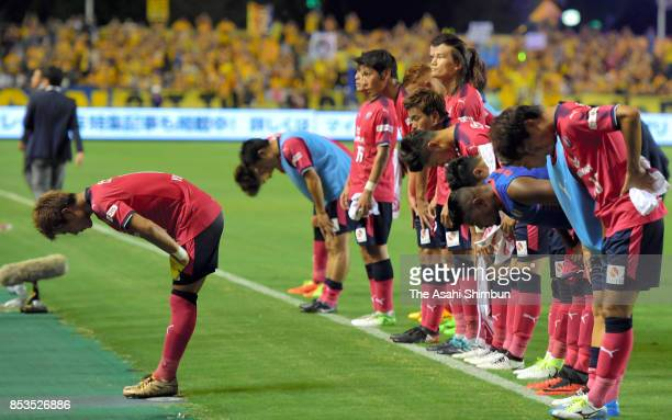 Yoichiro Kakitani and Cerezo Osaka players bow toward supporters after their 14 defeat in the JLeague J1 match between Cerezo Osaka and Vegalta...