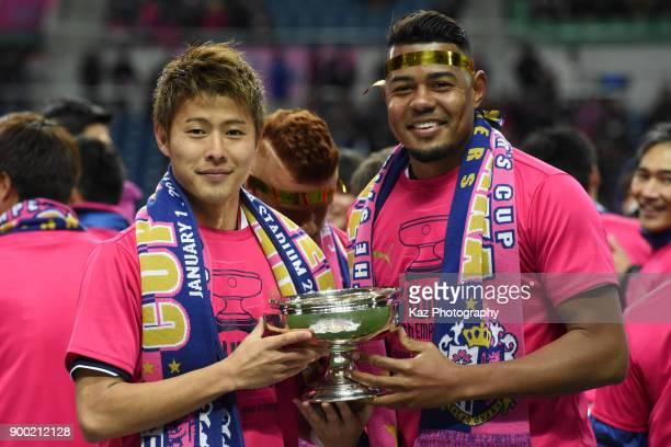 Yoichiro Kakitani and Ricardo Sandos of Cerezo Osaka hold the Emperor's Cup during the 97th All Japan Football Championship final between Cerezo...