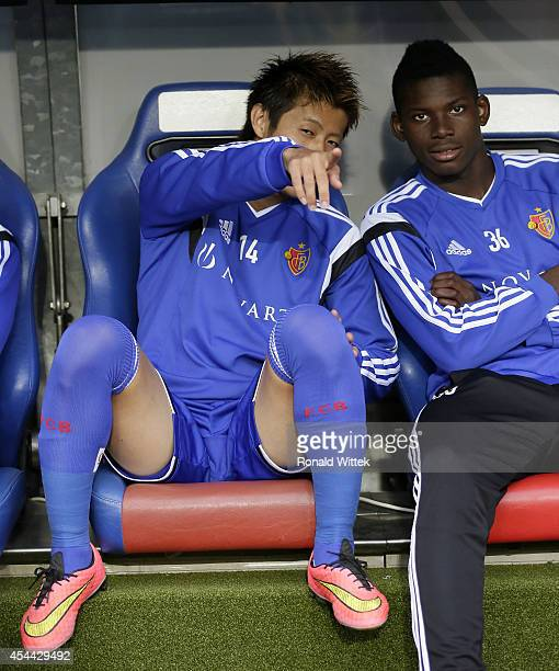 Yoichiro Kakitani of Basel reacts with Breel Embolo during the Raiffeisen Super League match between FC Basel and BSC Young Boys Bern at StJakobPark...
