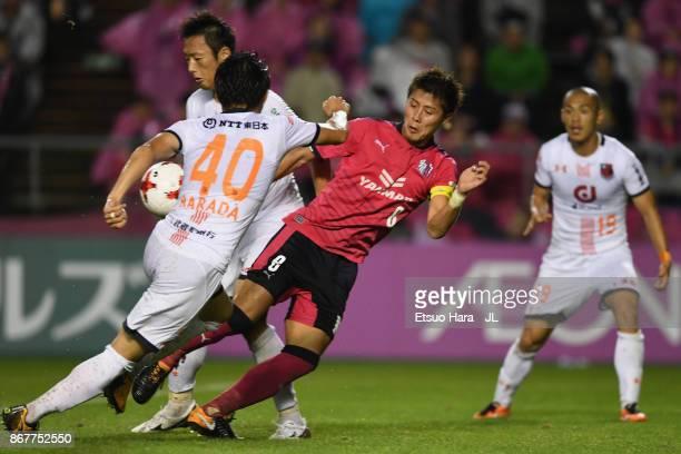Yoichiro Kakitani of Cerezo Osaka and Akimi Barada of Omiya Ardija compete for the ball during the JLeague J1 match between Cerezo Osaka and Omiya...