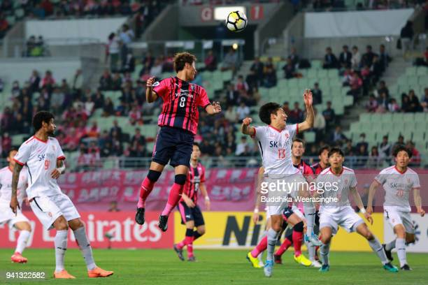 Yoichiro Kakitani of Cerezo Osaka and Chung Woon of Jeju United compete for the ball during the AFC Champions League Group G match between Cerezo...