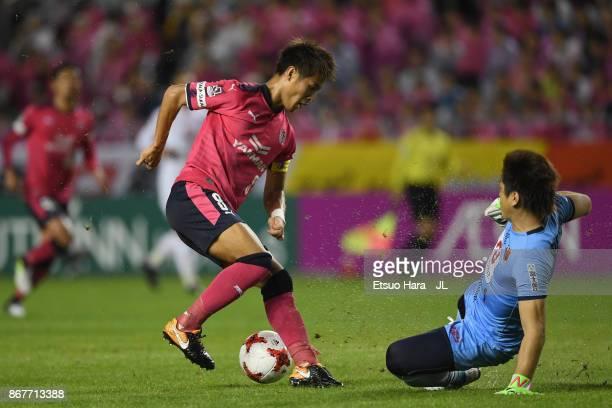 Yoichiro Kakitani of Cerezo Osaka and Nobuhiro Kato of Omiya Ardija compete for the ball during the JLeague J1 match between Cerezo Osaka and Omiya...