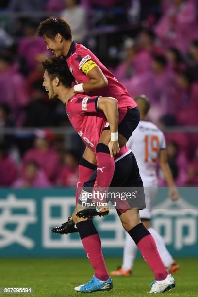 Yoichiro Kakitani of Cerezo Osaka celebrates scoring his side's second goal with his team mate Kenyu Sugimoto during the JLeague J1 match between...
