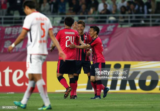 Yoichiro Kakitani of Cerezo Osaka celebrates scoring his side's second goal with his team mates Kazuya Yamamura and Atomu Tanaka during the AFC...