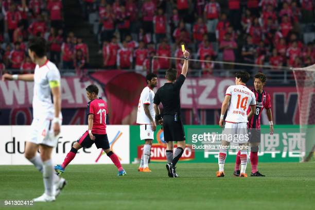 Yoichiro Kakitani of Cerezo Osaka is shown an yellow card during the AFC Champions League Group G match between Cerezo Osaka and Jeju United at Osaka...