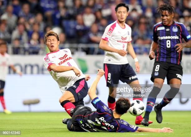 Yoichiro Kakitani of Cerezo Osaka is tackled during the JLeague J1 match between Gamba Osaka and Cerezo Osaka at Suita City Football Stadium on April...