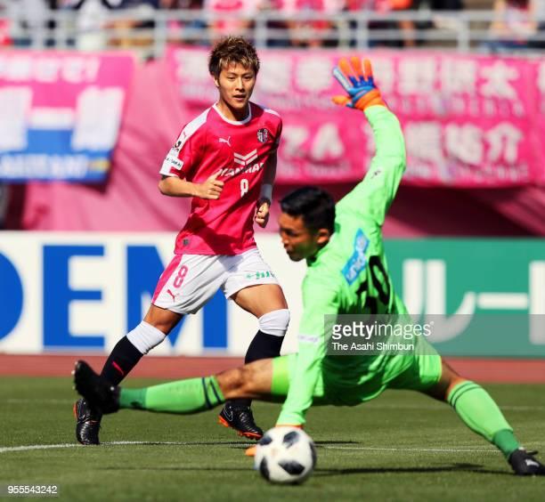 Yoichiro Kakitani of Cerezo Osaka scores the opening goal past Kenta Tokushige of VVaren Nagasaki during the JLeague J1 match between Cerezo Osaka...