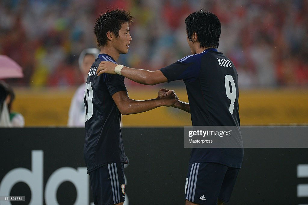 Yoichiro Kakitani (L) of Japan celebrates scoring his team's first goal with his team mate Masato Kudo during the EAFF East Asian Cup match between Korea Republic (South Korea) and Japan at Jamsil Stadium on July 28, 2013 in Seoul, South Korea.