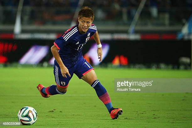 Yoichiro Kakitani of Japan runs with the ball during the KIRIN CHALLENGE CUP 2014 international friendly match between Japan and Venezuela at the...