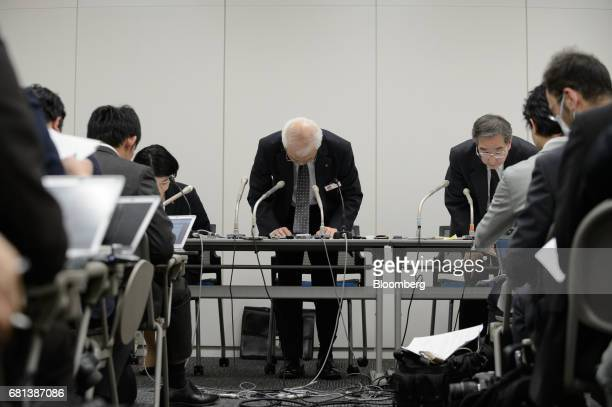 Yoichiro Nomura chief financial officer of Takata Corp center bows during a news conference at the Tokyo Stock Exchange in Tokyo Japan on Wednesday...
