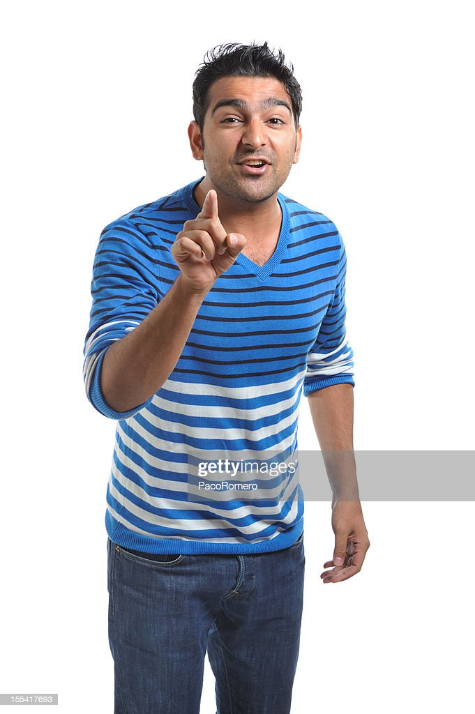 Yoing Indian businessman gesturing with finger and communicating : Stock Photo