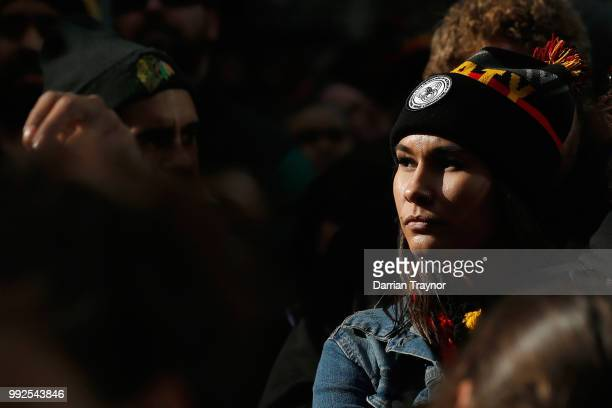 A yoiung woman looks on as thousands of people take part in the NAIDOC march on July 6 2018 in Melbourne Australia The march marks the start of...