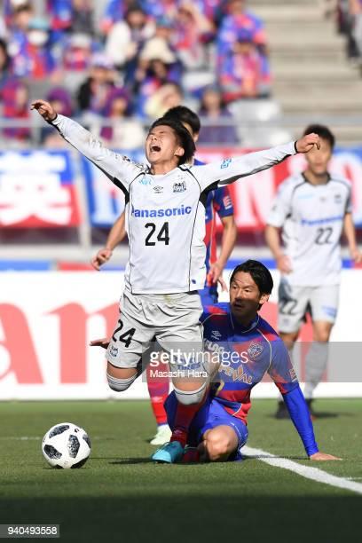 Yojiro Takahagi of FC Tokyo and Haruya Ide of Gamba Osaka compete for the ball during the J.League J1 match between FC Tokyo and Gamba Osaka at...