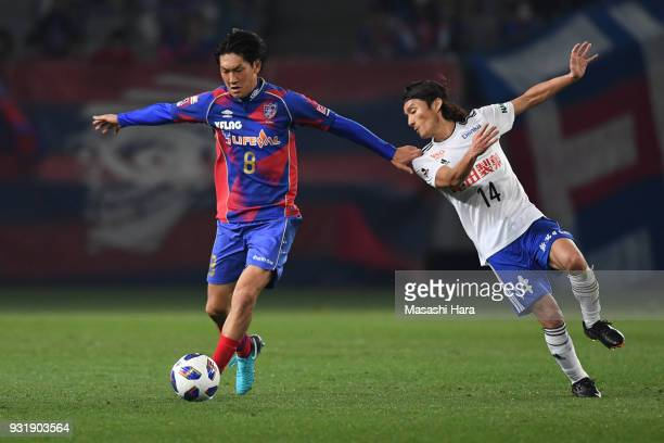 Yojiro Takahagi of FC Tokyo and Tatsuya Tanaka of Albirex Niigata compete for the ball during the JLeague YBC Levain Cup Group A match between FC...