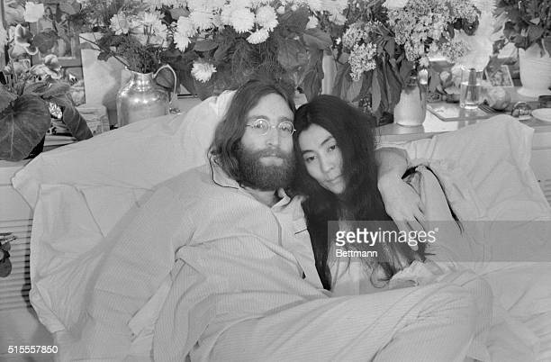 Yoko and John...Beatle John Lennon and Yoko Ono, his bride of three months at the time this photo was made in Montreal in June 1969, pose in bed. His...