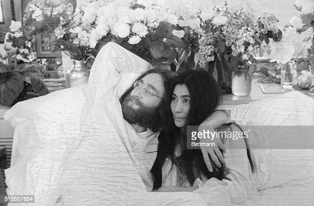 Yoko and JohnBeatle John Lennon and Yoko Ono his bride of three months at the time this photo was made in Montreal in June 1969 pose in bed His first...