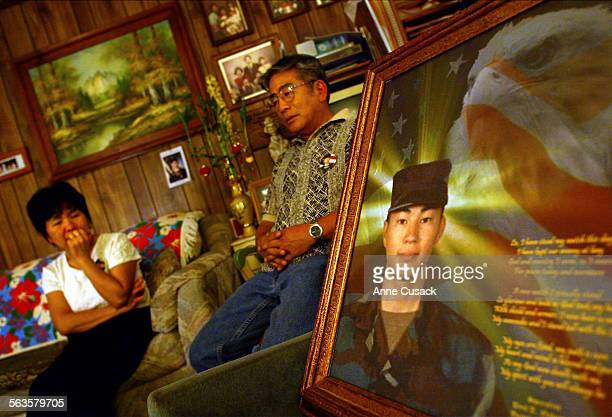 Yoko and Paul Nakamura with the portrait created by Carlos Jones from Ohio in their living room Paul Toku Nakamura was 21 when he was killed in Iraq...
