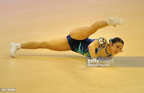 Yoko Kishiro of Japan compete in the FinalSenior Individual Women during the 5th Asian Aerobic Gymnastics Championships at Nguyen Du Culture and...